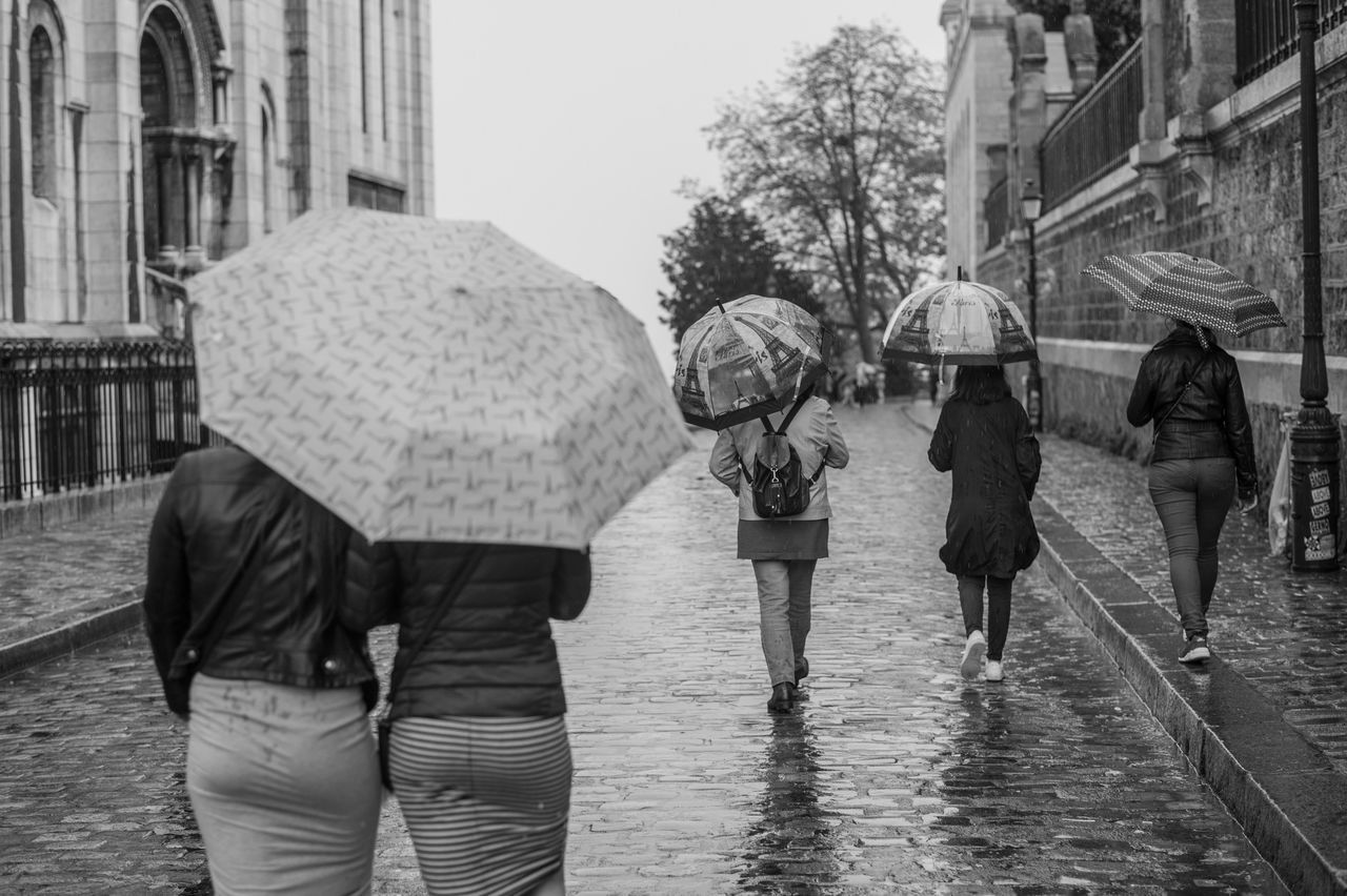 City Day Friendship Group Of People Leisure Activity Lifestyles Men Outdoors Paris Protection Rain RainDrop Rainy Season Real People Rear View Togetherness Travel Walking Warm Clothing Water Weather Wet Let's Go. Together.