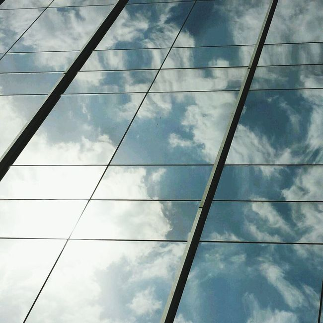 Just a mirror for the sun... Reflection Cloud_collection  Clouds Glass Wall