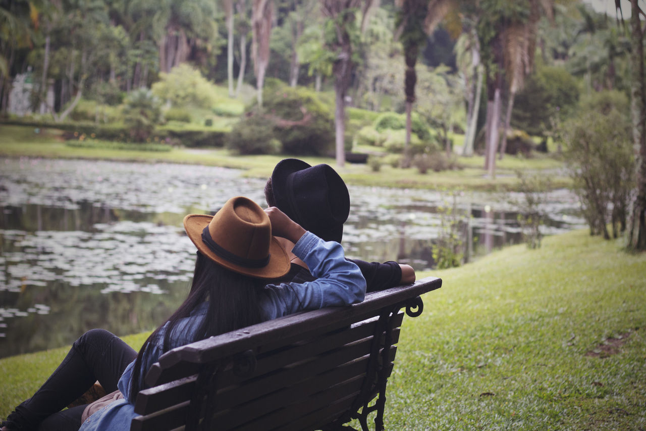 Beauty In Nature Bonding Day Hat Lake Leisure Activity Lifestyles Men Nature Outdoors People Real People Relaxation Sitting Togetherness Tree Two People Vacations Water