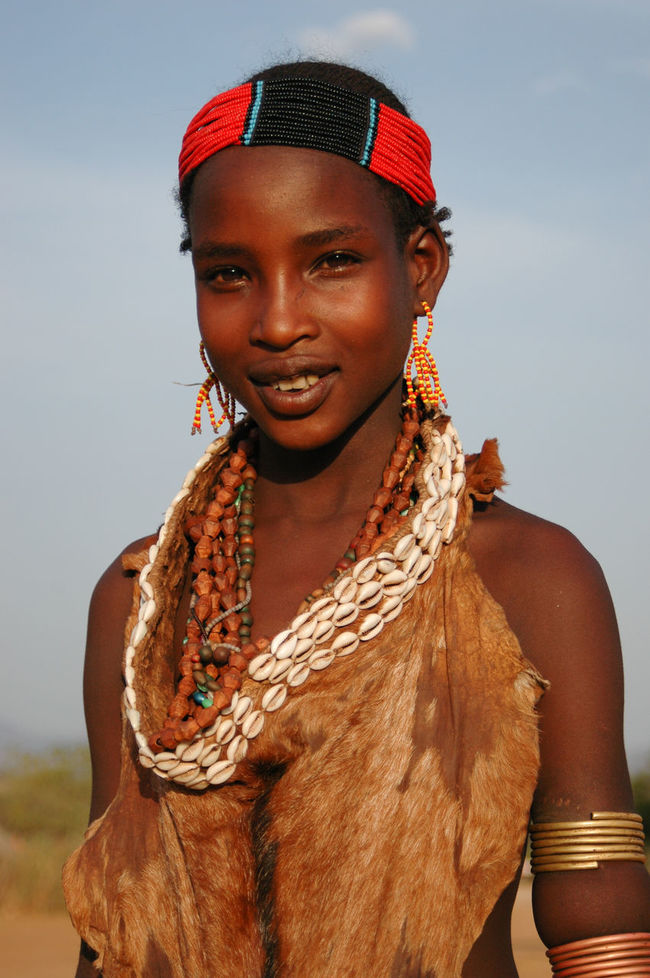 Hamer girl in Turmi, southern Ethiopia Africa Culture Ethiopia Hamer Happy Headdress Holiday Joy Looking At Camera One Young Woman Only Portrait Smile Vacation Destination Waist Up