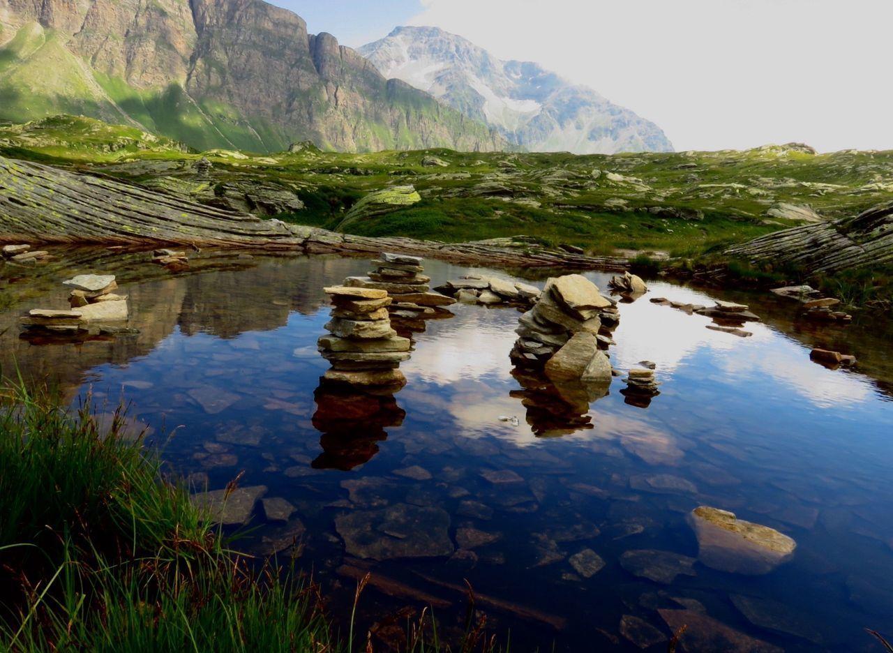 Water Reflections of the Cairns . San Bernardino Pass , Graubünden . Switzerland Stone Stones Lake Mountains Mountain Alp Alps San Bernardino Suisse  Schweiz Svizzera Grigioni Blue Cloud Colour Of Life