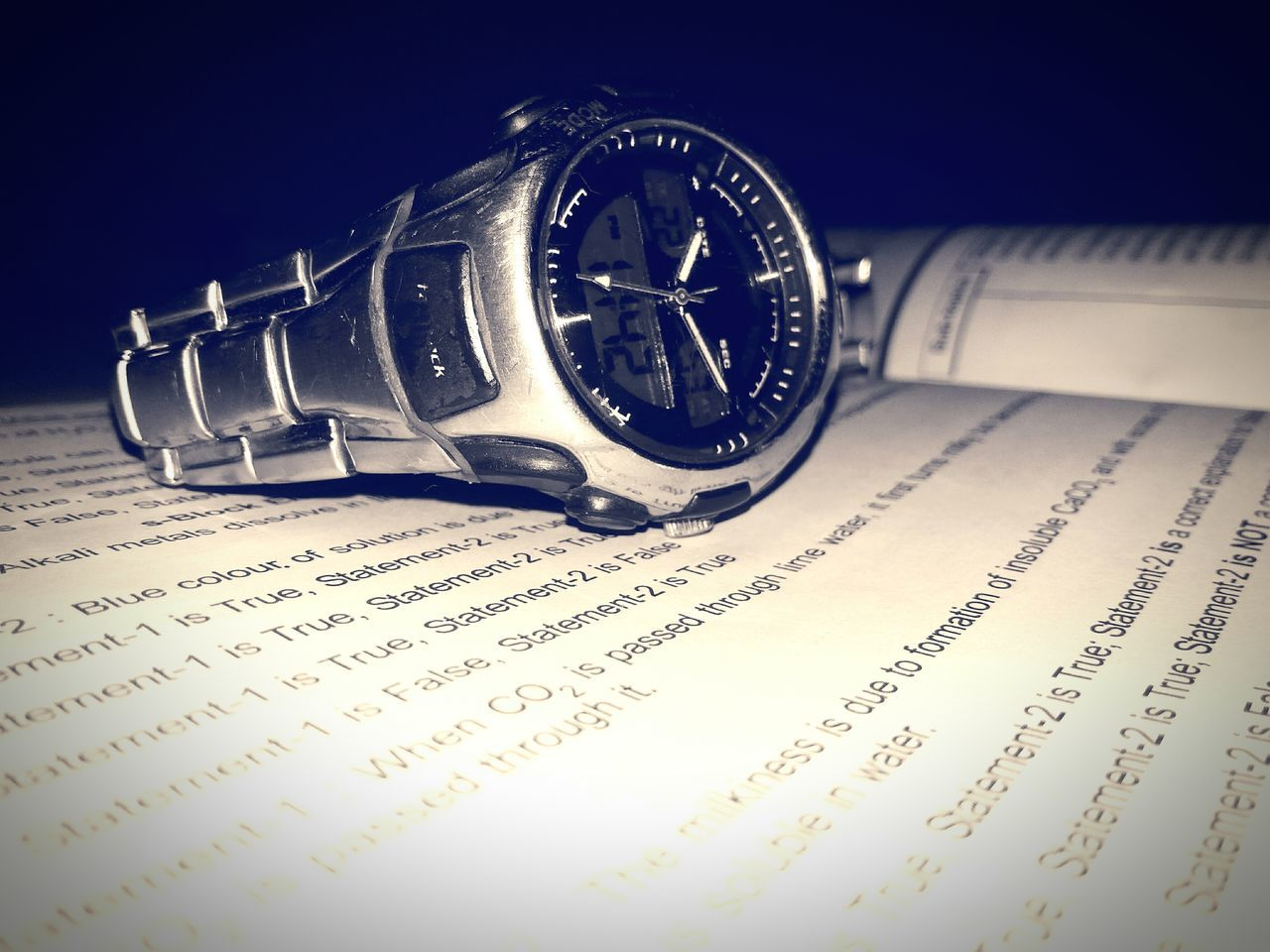 TIME STANDS STILL... Minute Hand No People Newspaper Text Information Medium Communication Watch Wrist Watch Night Study Time Studying For Exams :-( Close-up Studying Hard