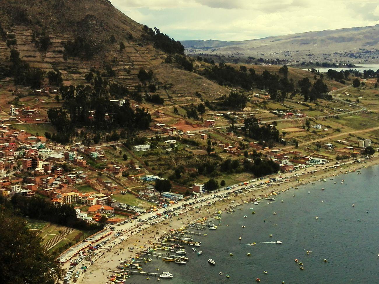 como tus ojos se reflejan en el mar Melancolia Lago Titicaca Mountain Cityscape