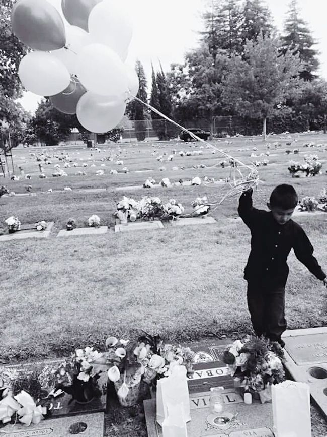 The Photojournalist - 2016 EyeEm Awards This is my grandson Joseph, holding balloons for his Daddy in Heaven..... This is our reality...violently taken...😢💔My hope is his death isn't in vain... Loveshisdaddy Foreveryoung  Forever29 Alwaysonmymind Lovemyboy Lovemyson Lovemygrandsons Balloons In The Sky Forever In My Heart StopTheViolence Thechildrenhurt Livingwithouthisdaddy