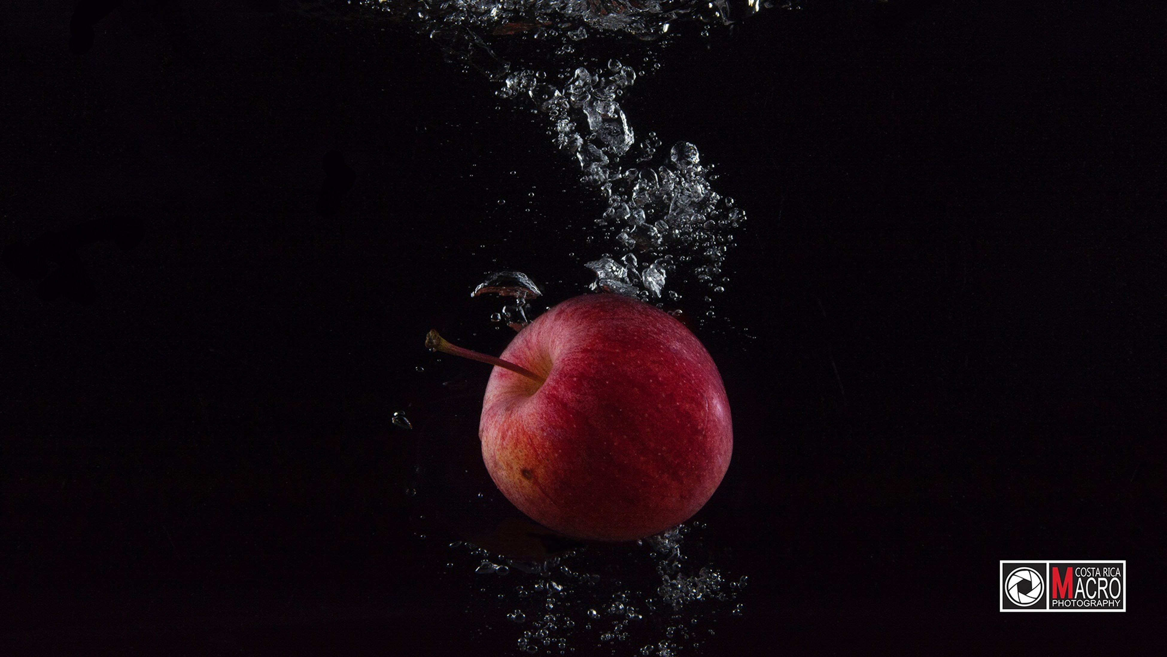 fruit, healthy eating, red, splashing, studio shot, motion, black background, food, impact, close-up, no people, hitting, freshness, day