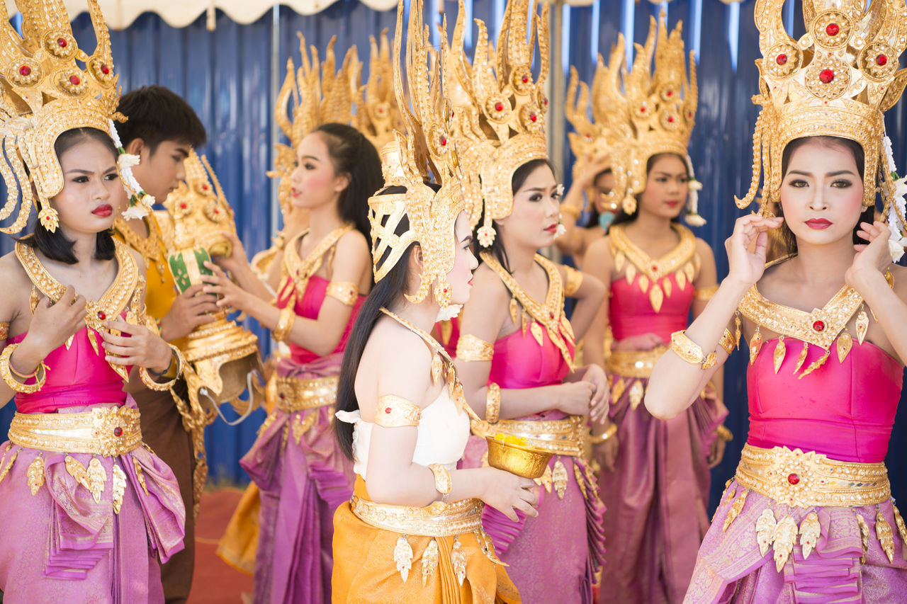 celebration, indoors, traditional clothing, cultures, dancing, large group of people, day, young adult, people