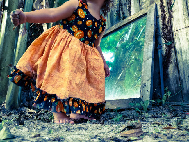 Child Close-up Dirt Dress Girl Halloween Mirror Orange Outside Person Playing Reflection Seasonal TakeoverContrast Take