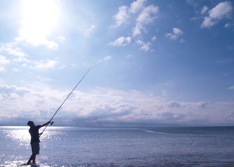 Blue Blue Sky Casting Casting Rod Cloud - Sky Clouds Day Fisherman Fishing Fishing Rod Horizon Over Water Leisure Activity Lifestyles Man Nature Ocean Outdoors Scenics Sea Sea And Sky Sea Fishing Sky Sky And Clouds Sun Water