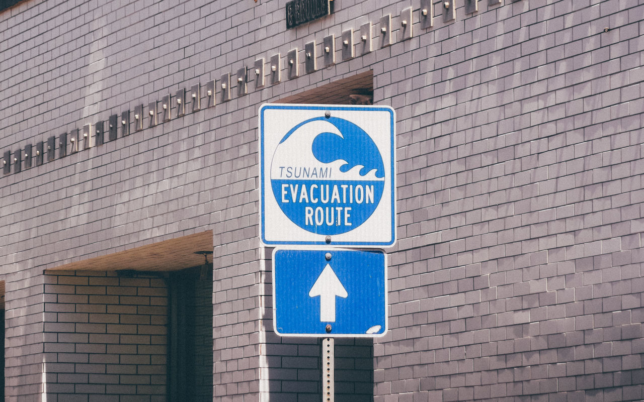 Evacuation route sign at Venice Beach Arrow Blue Blue Sign Bricks California Color Colour Contrast Evacuation Evacuation Point Los Angeles, California Losangeles Sign Tsunami Venice Venice Beach