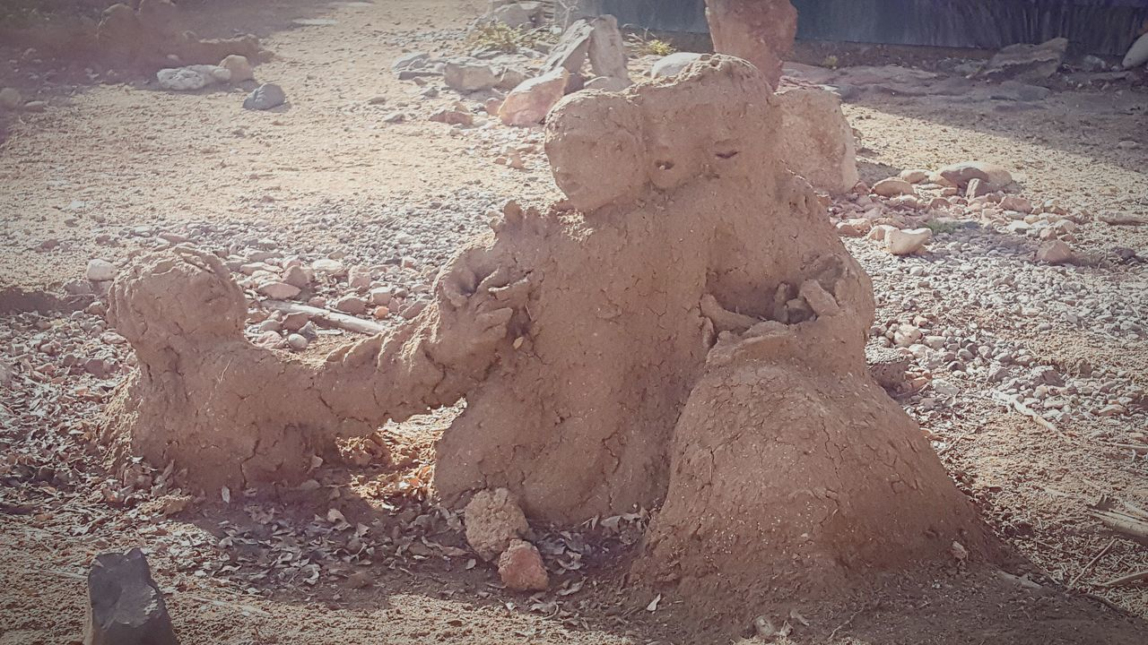 There were mud statues of people that were all over this yard I was driving by. They were showing signs of deterioration caused by recent rain and snow but were still pretty neat. Mud Artistic Creative Nature Sculpture Garden Sculptures Mud Play Garden Decor Creative Arts  Expressive Sculpture Yard Art