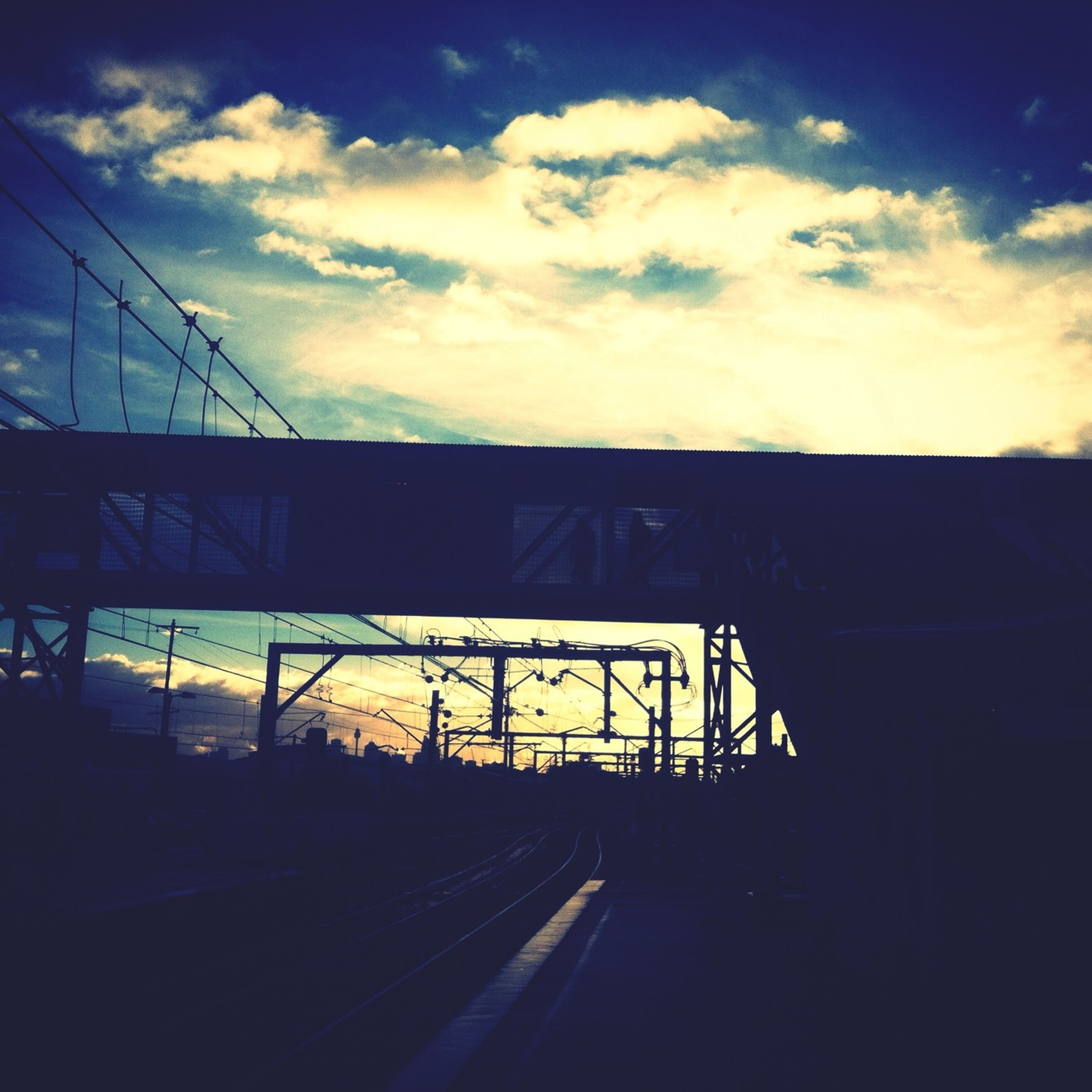 sunset, sky, transportation, connection, cloud - sky, built structure, architecture, silhouette, railroad track, bridge - man made structure, the way forward, rail transportation, cloud, dusk, diminishing perspective, cloudy, no people, outdoors, road, orange color