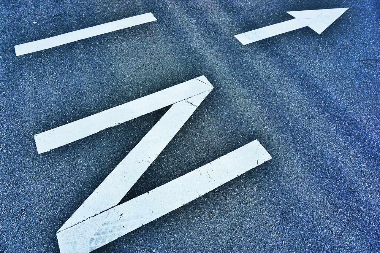 High Angle View Of Markings On Road