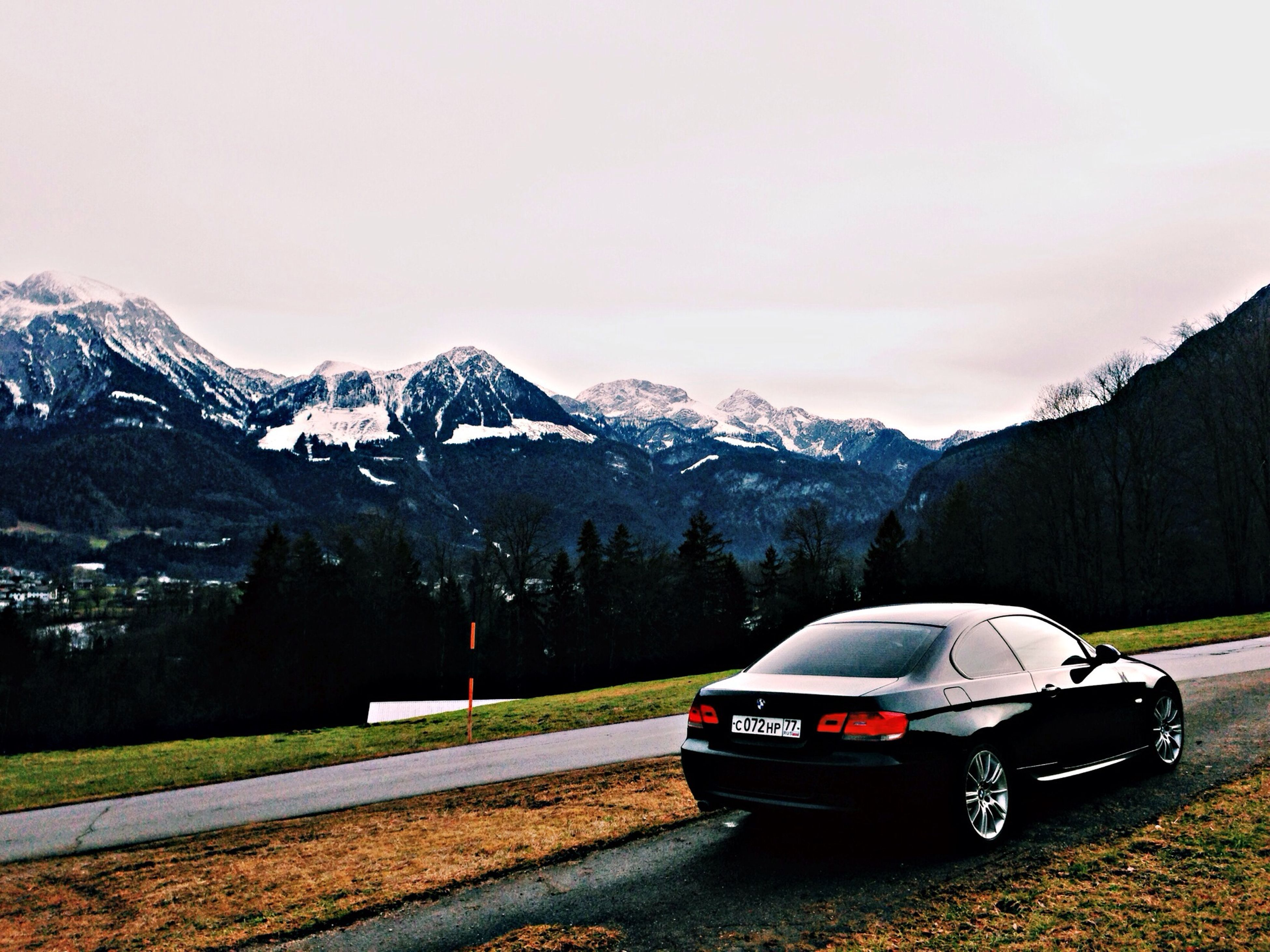 mountain, snow, winter, cold temperature, mountain range, car, snowcapped mountain, transportation, land vehicle, season, landscape, scenics, weather, beauty in nature, tranquil scene, mode of transport, road, sky, nature, tranquility