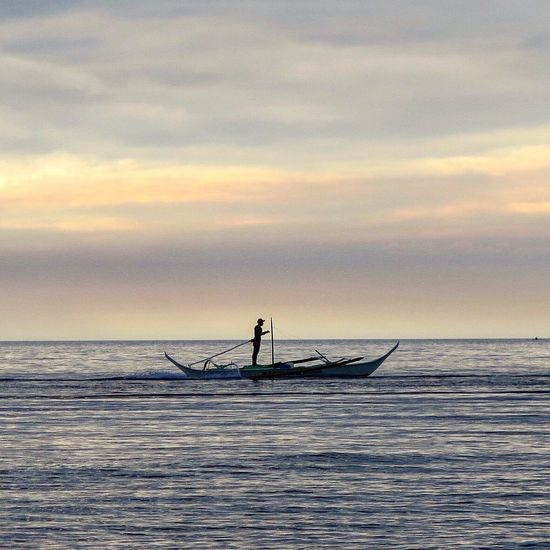 Tran.quil.i.ty Sea Water Sky Nature Outdoors Horizon Over Water Beauty In Nature Fisherman Nautical Vessel Philippines Waterfront Real People Sunset Occupation Men Scenics Fishing Net Cloud - Sky Day One Person