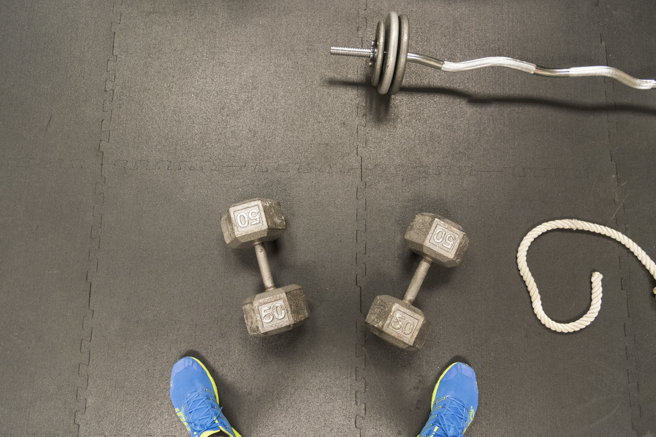 Looking down at weights Adult Barbell Cardio Club Crossfit Diet Diminishing Perspective Dumbbells Exercise Fitness Food Goals Gym Health Heart Legs Male Movement Muscle Personal Perspective Quadriceps Rope Training Weights