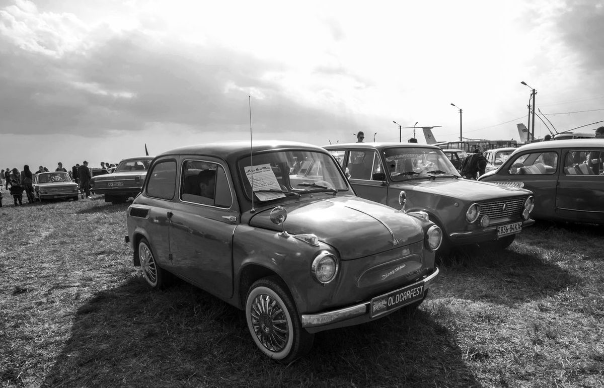 Old Car Fest. Zaporozhets ZAZ-965 Antique Blackandwhite Car Classic Cloud Day Dramatic Sky Farsta Front View Kiev Land Vehicle Mode Of Transport Monochrome Old Outdoors Parked Retro Road Sky Transportation Ukraine Vehicle Vintage Zaporozhets ZAZ-965