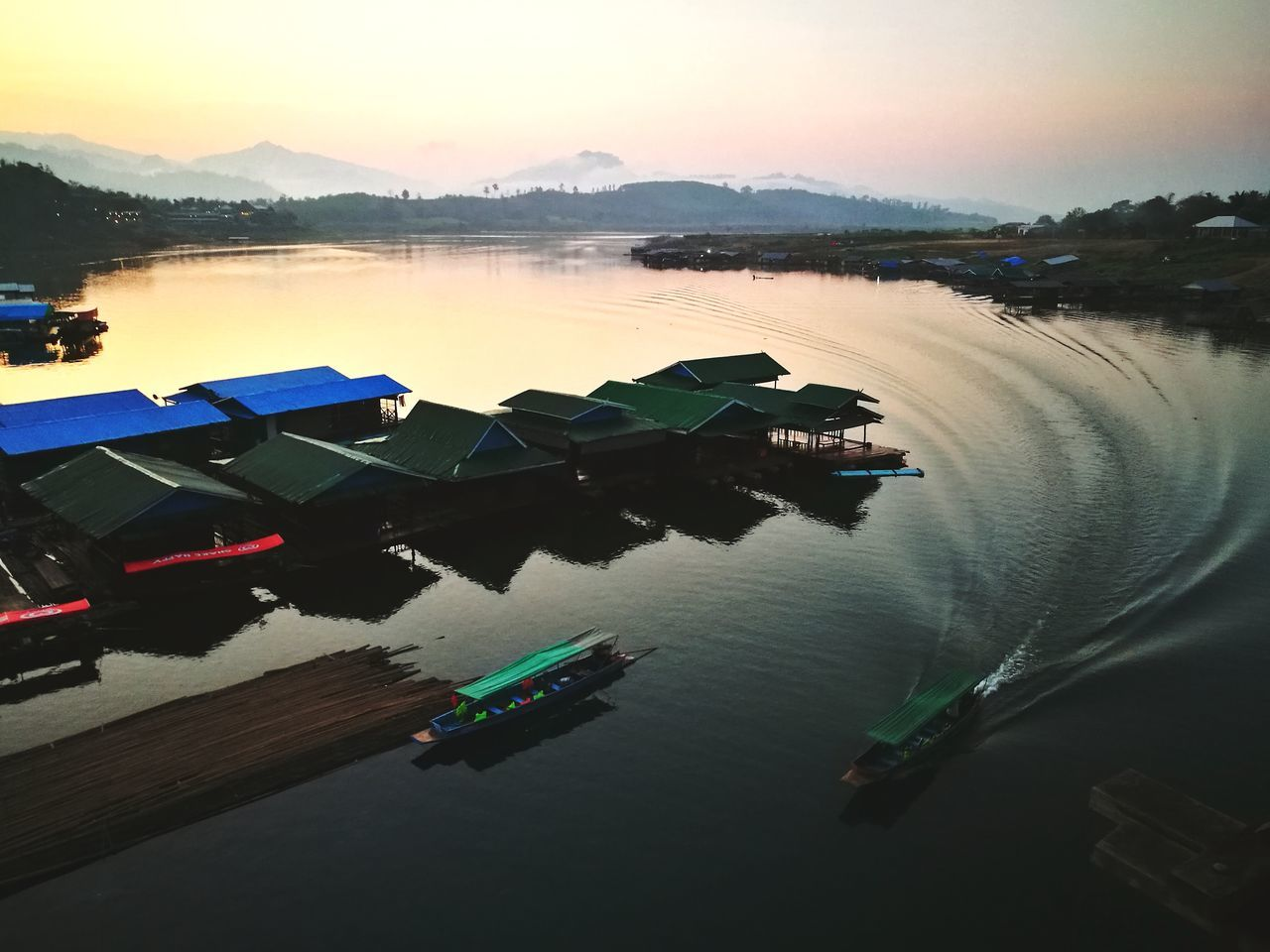 Life In Motion Life Is Beautiful Water Reflection Sunset Lake Dusk Tranquility Nature Outdoors Mountain Sky Social Issues Harbor No People Floating On Water Beauty In NatureDay Boats And Water Travel Photography Boat Dock Boathouse Boating Lake Life