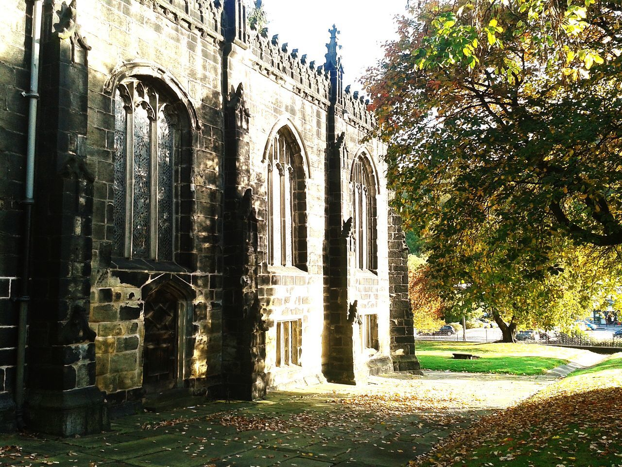Sunday Mass Praying Praising The Lord Singing Praying Eyem Nature Lovers  Enjoying Life Autumn 2015 Check This Out Churches Architectural Detail Autumn Beautiful Stonework Medieval Gravestones Peaceful Place TreePorn Hello World Fallbeauty Sunlight And Shadow Leaded Windows Churchyard Oldbuildings Autumn Leaves Flagstones