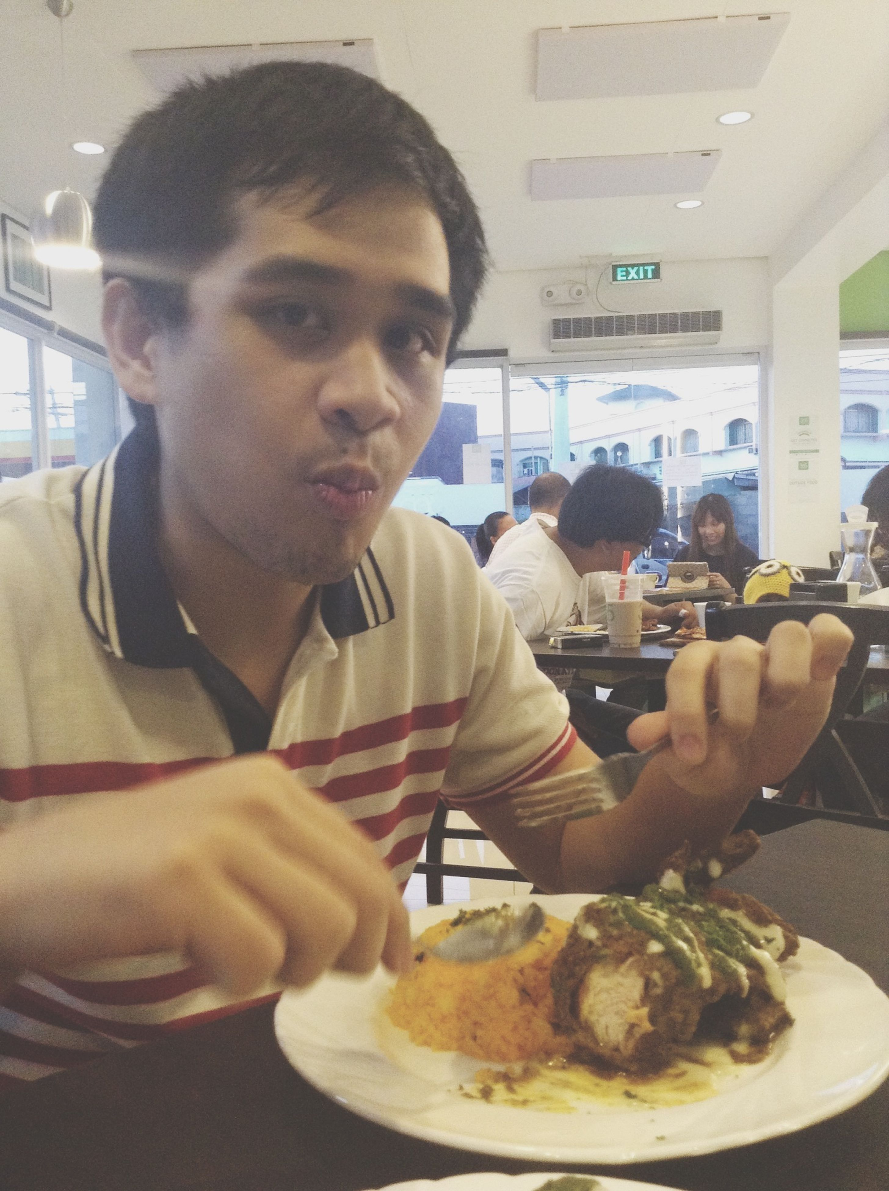 indoors, young men, lifestyles, person, leisure activity, food and drink, young adult, casual clothing, holding, communication, sitting, restaurant, mid adult, looking at camera, front view, mid adult men, portrait
