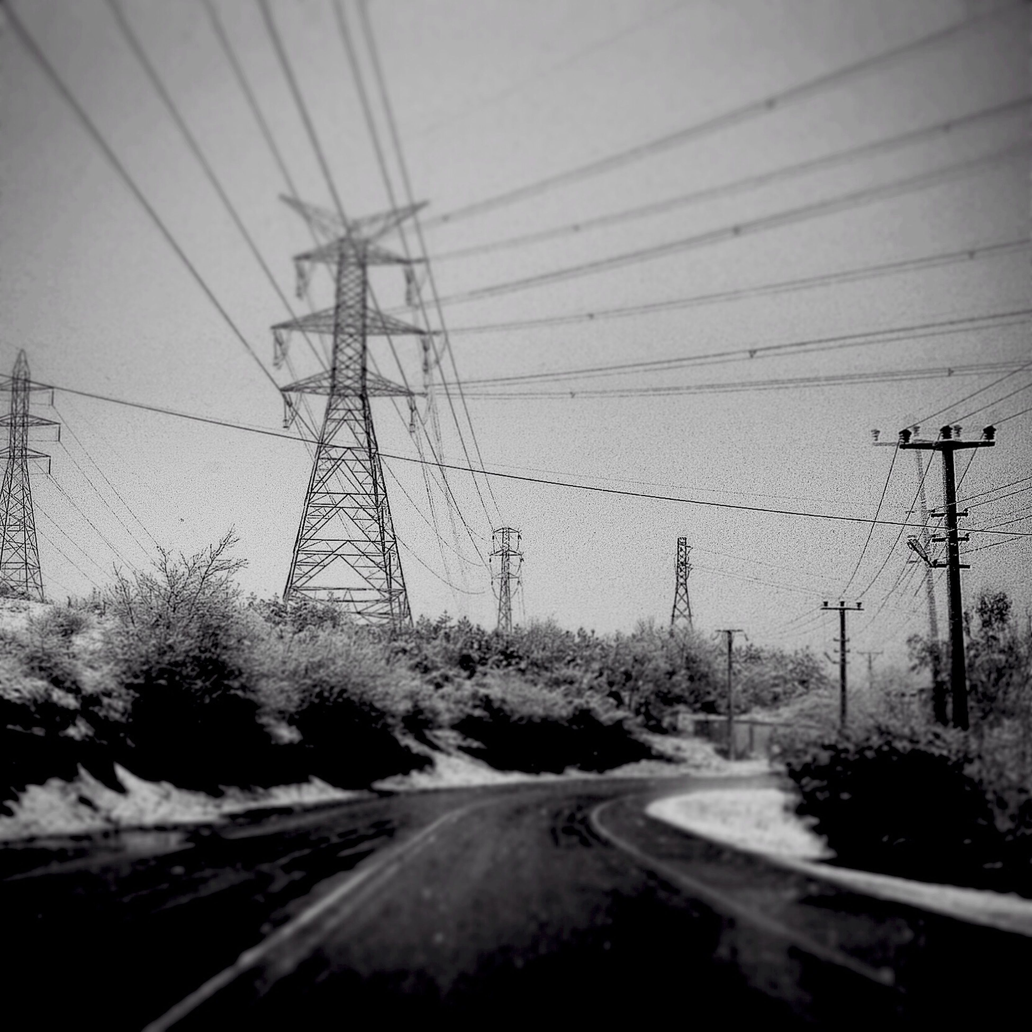 electricity pylon, transportation, power line, electricity, power supply, fuel and power generation, road, connection, cable, the way forward, diminishing perspective, sky, power cable, vanishing point, no people, railroad track, clear sky, nature, weather, outdoors