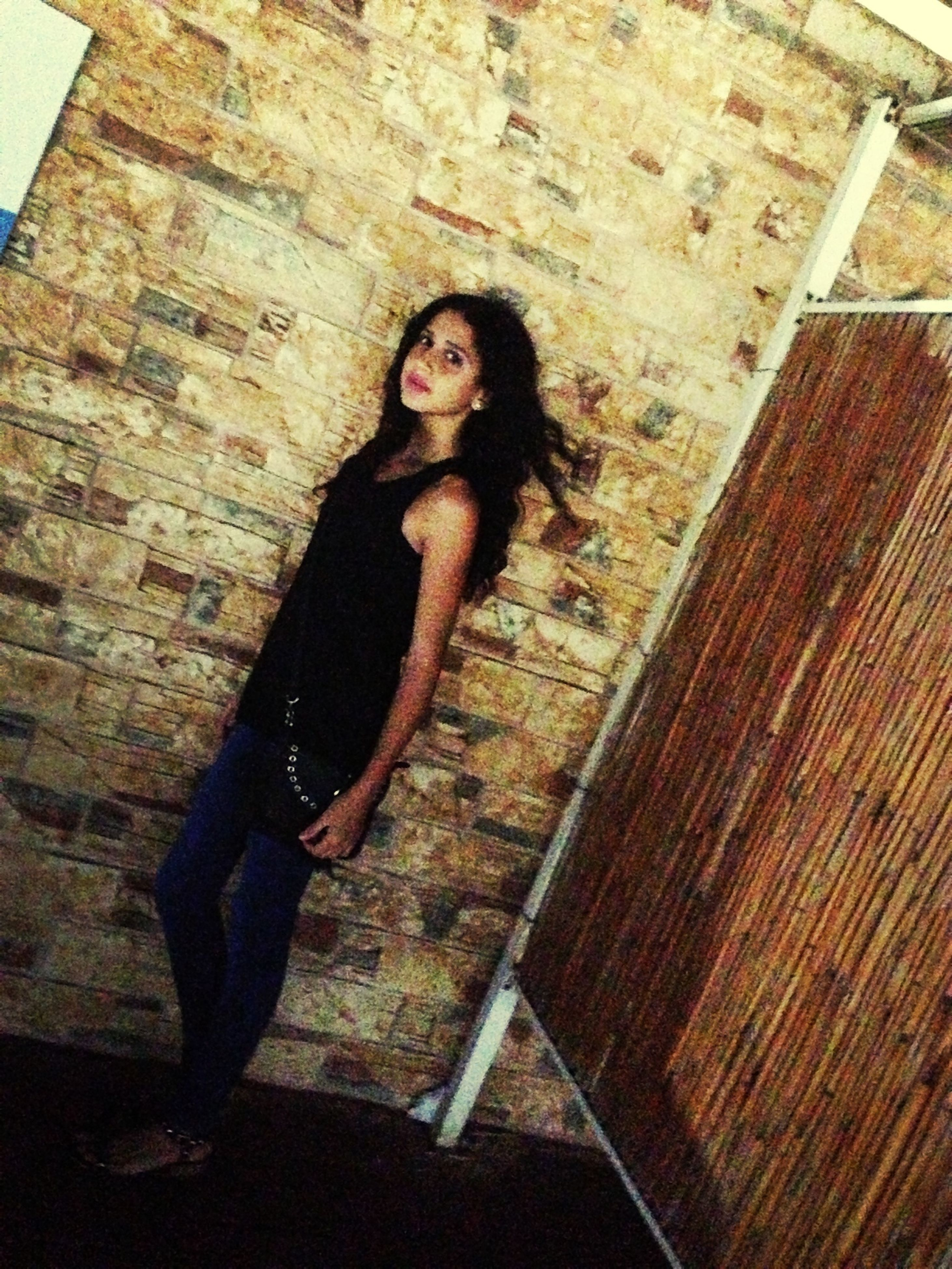 young adult, person, young women, portrait, looking at camera, wall - building feature, front view, lifestyles, standing, brick wall, indoors, casual clothing, built structure, architecture, full length, leisure activity, smiling