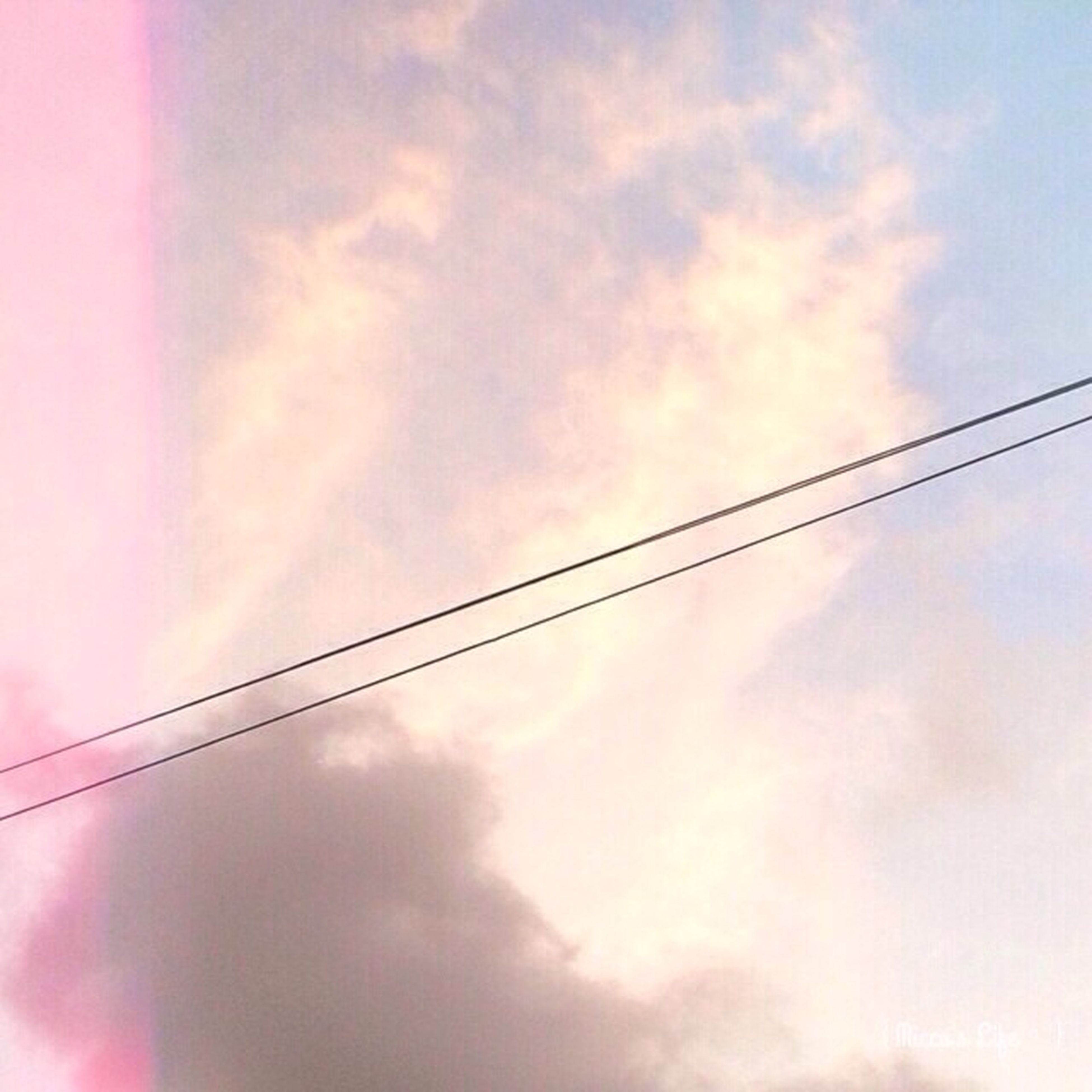 low angle view, sky, cloud - sky, power line, cloudy, cable, cloud, electricity, connection, beauty in nature, nature, power supply, tranquility, scenics, outdoors, no people, electricity pylon, overcast, sunset, tranquil scene