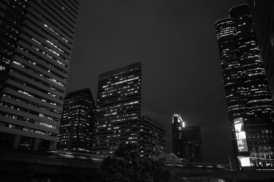 City Night Skyscraper Architecture Illuminated Building Exterior Modern Business Finance And Industry City Life Outdoors Travel Destinations Urban Skyline Financial District  Built Structure Sky Cityscape Downtown District No People Office Building Exterior