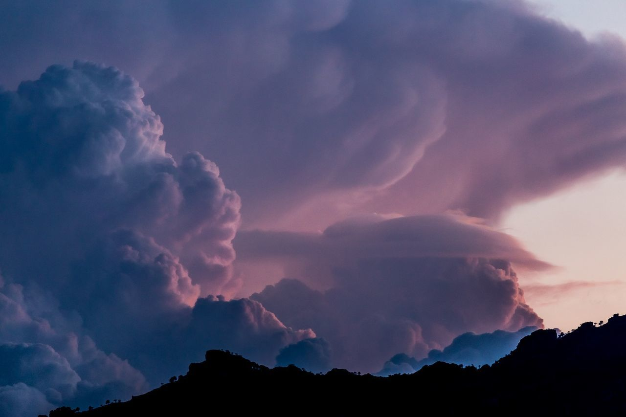 Cumulus clouds over landscape