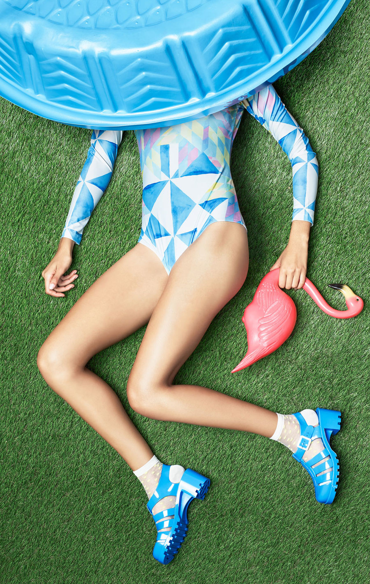 blue fake grass Flamingo Grass Green color jelly shoes legs lying down one person only women pool socks swimming pool swimsuit fashion young adult