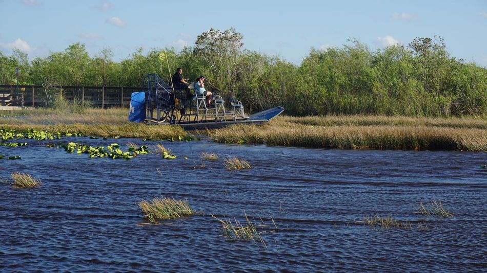 Airboat Real People Tree Water Nautical Vessel Mode Of Transport Nature Lake Men Transportation Lifestyles Growth Sky Outdoors Waterfront Occupation Beauty In Nature Plant Day One Person