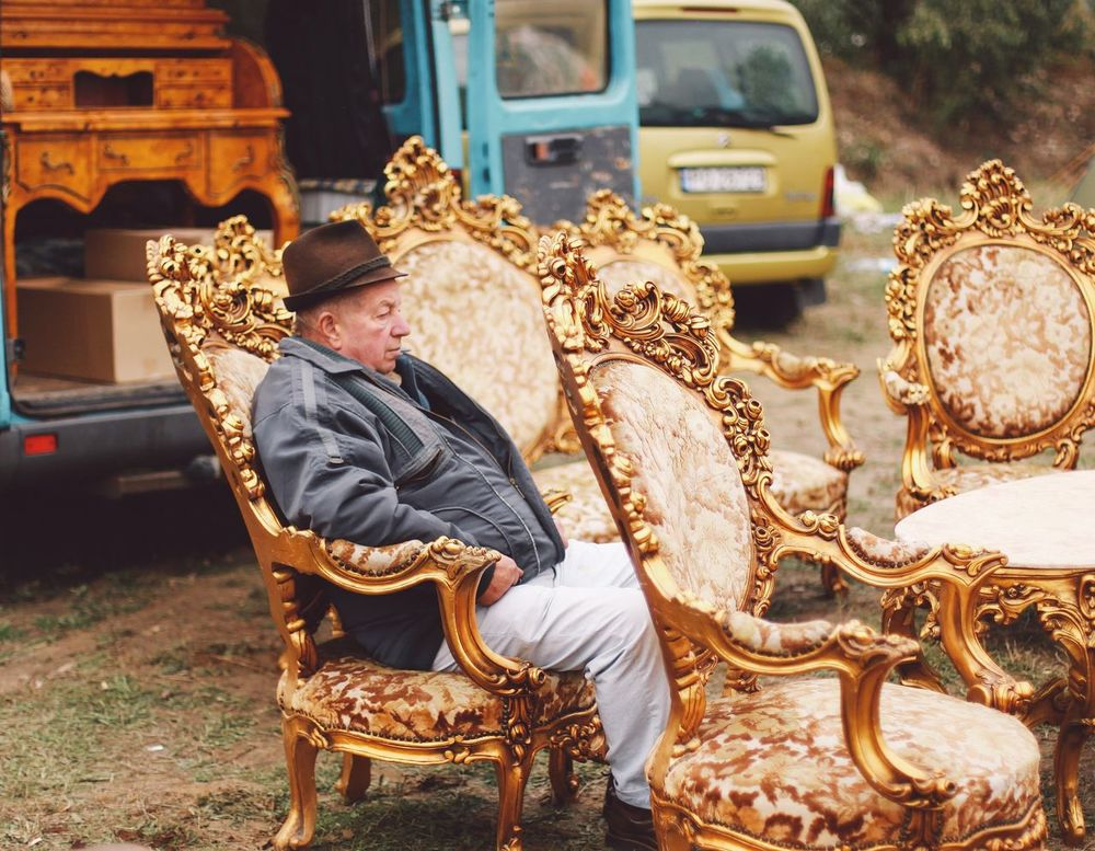 Market Fleamarket Flea Markets Armchair Armchairs 43 Golden Moments Negreni Bihor Cluj One Person Sitting Resting Traditional Seller Old-fashioned Old Furnitures People And Places Snap a Stranger Art Is Everywhere