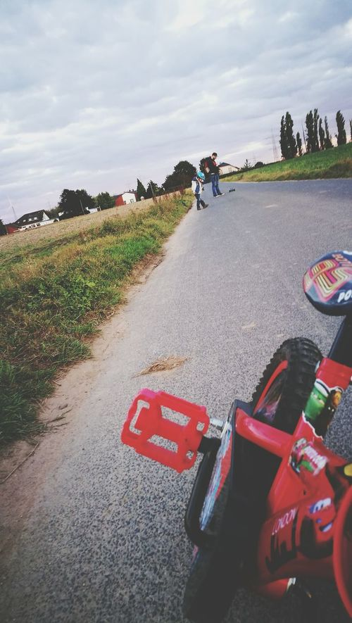 Transportation Road Bicycle Land Vehicle Rear View Grass The Way Forward Mode Of Transport Cycling On The Move Front View Sky Day Cloud - Sky Country Road Outdoors Countryside Cycle Diminishing Perspective Red Colour And Patterns My Creation Bye JasminSbell TakeoverContrast