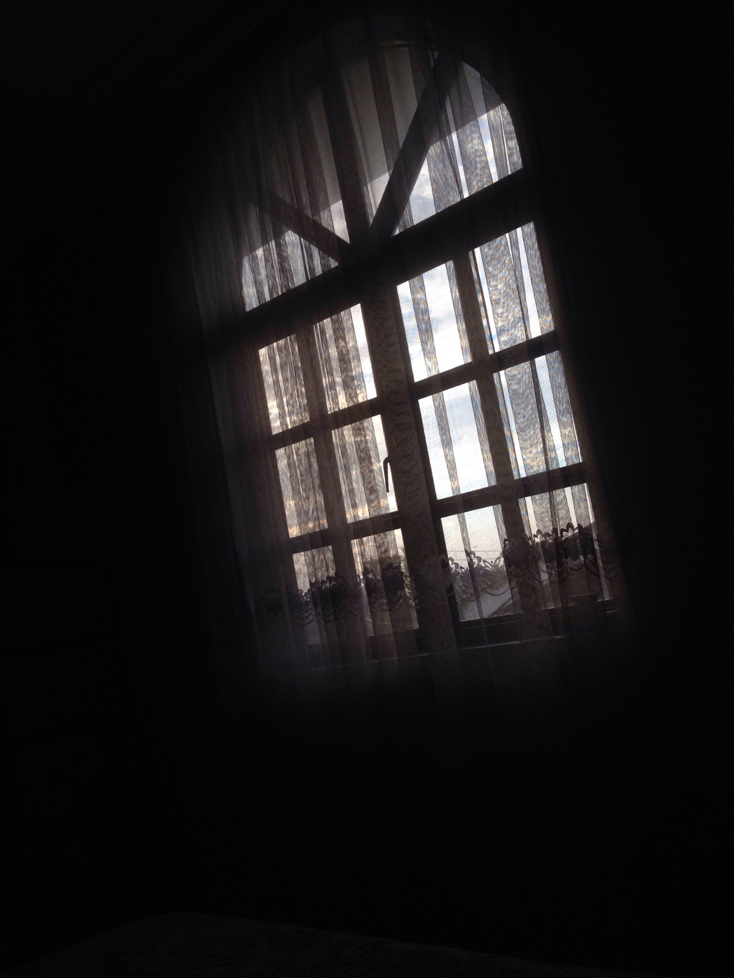 indoors, window, glass - material, transparent, home interior, dark, built structure, architecture, sunlight, house, interior, curtain, no people, day, silhouette, glass, looking through window, room, ceiling, window frame