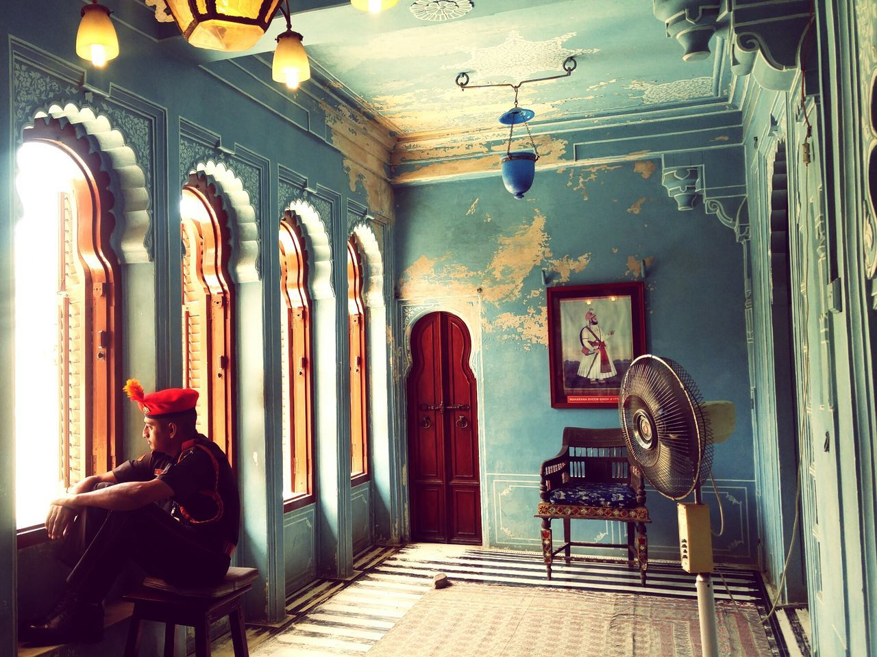 Indoors  Archival Illuminated Architecture Day Fort Travel Photography Incredible India Ancient Old Old Buildings Guard Duty In Deep Thought Summer Blue City, Jodhpur Adult Single Old Fashioned. Lamps Standing Fan Wooden Doors