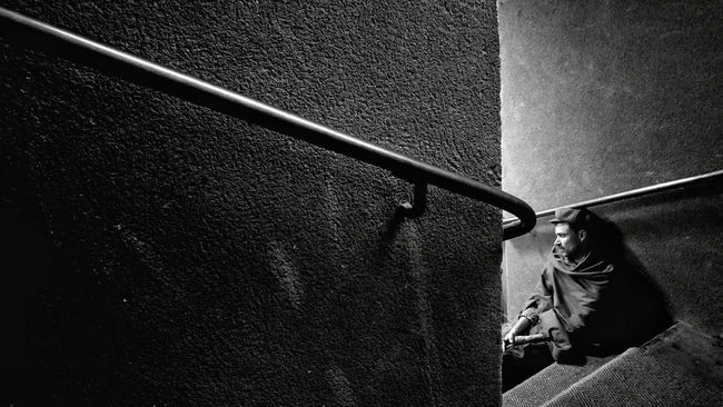 street 05 | guy with a blanket, sleeping on a stairway | Monochrome Photography One Person Mio Schweiger Stair Street Photography Waiting ... Sleeping Man Handrail  Loneliness And Sadness