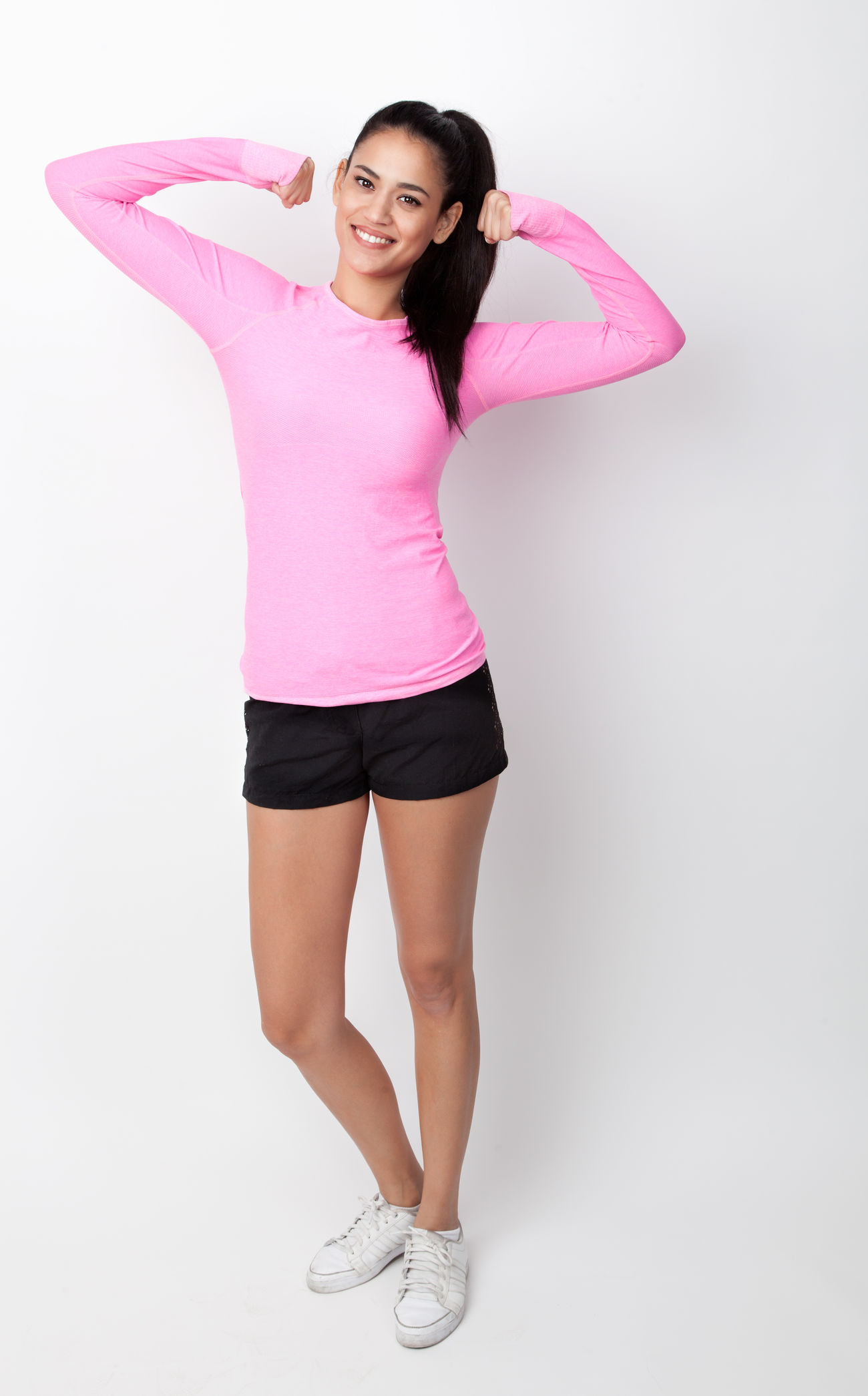 Portrait of a young woman in sport dress Attractive Beautiful Casual Clothing Cheerful Clothes Day Fashion Fit Fitness Full Girl Isolated Lady Lifestyle Model People Person Pink Shape Slim Standing Studio White Background Woman Young