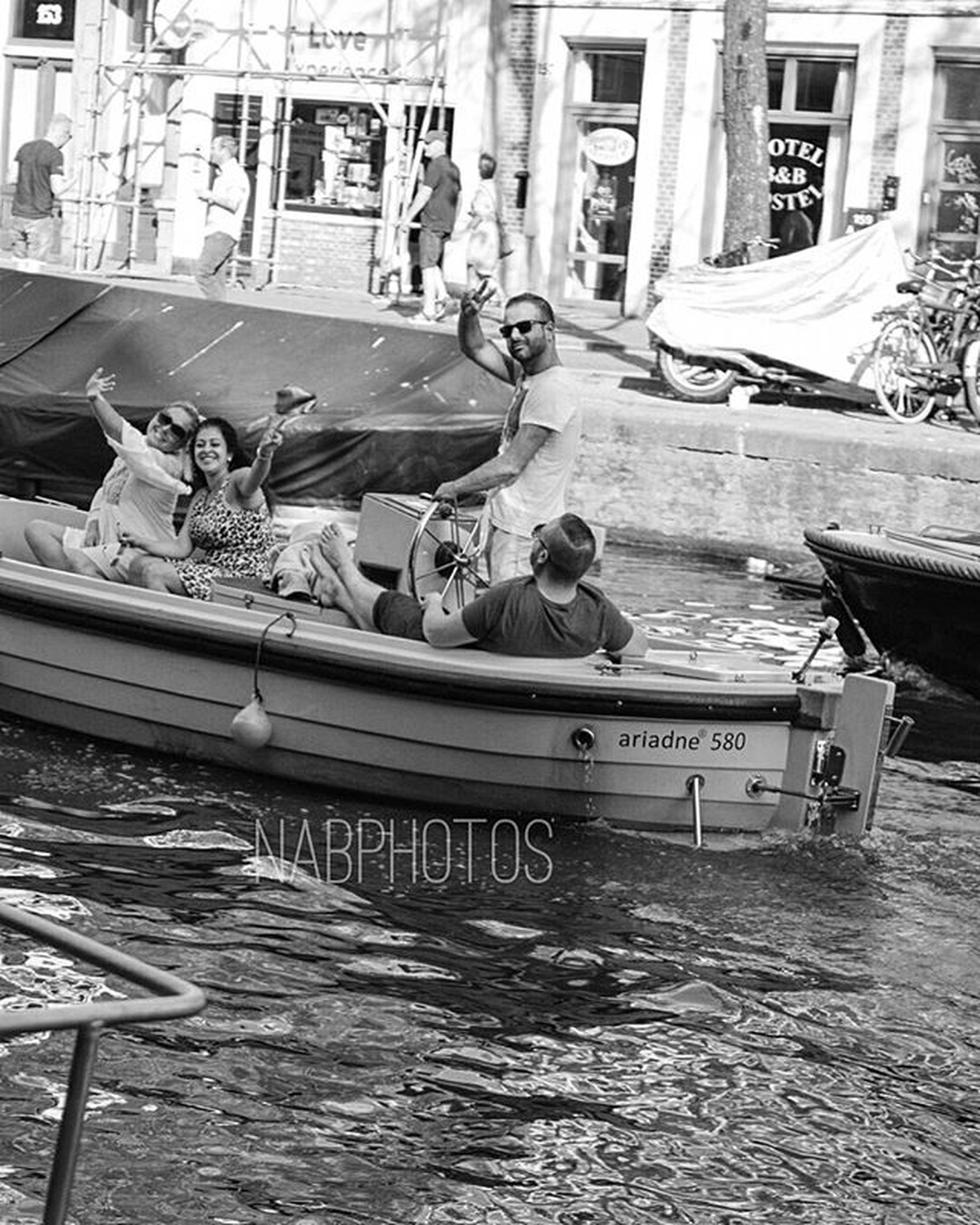 built structure, building exterior, architecture, water, transportation, nautical vessel, boat, day, high angle view, moored, outdoors, incidental people, mode of transport, large group of objects, canal, sunlight, house, chair