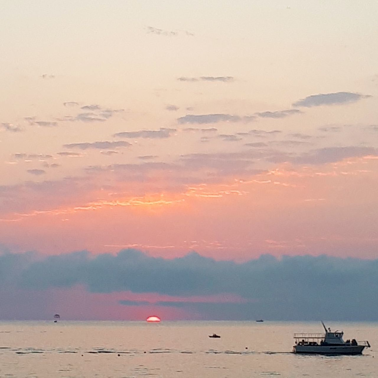 sunset, beauty in nature, water, scenics, nature, sky, sea, tranquility, cloud - sky, no people, transportation, nautical vessel, outdoors, horizon over water, bird, animal themes, day