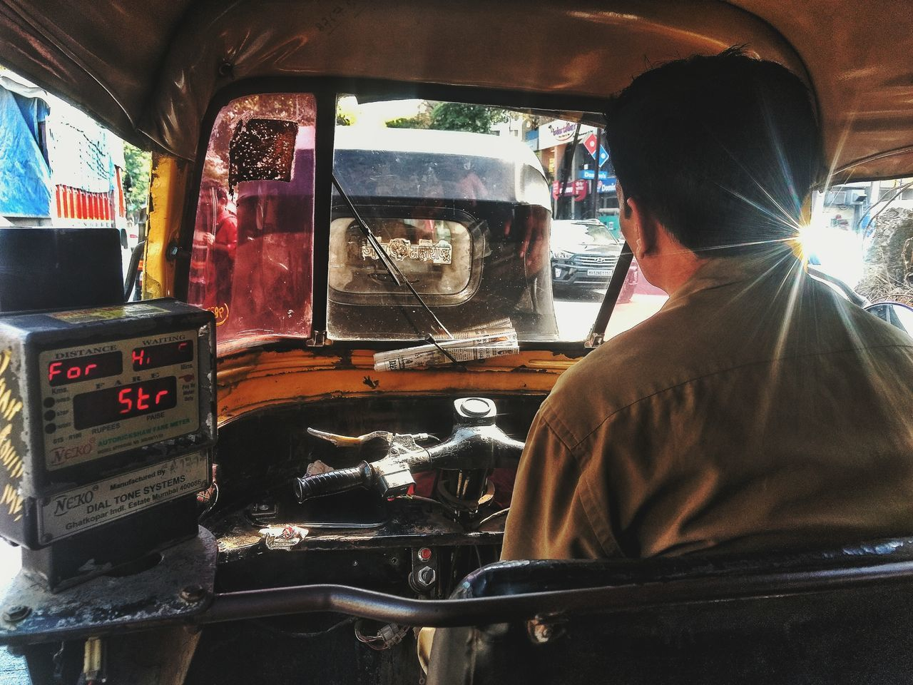 car, transportation, land vehicle, mode of transport, vehicle interior, car interior, driving, real people, windshield, one person, men, rear view, day, sunlight, occupation, sitting, working, outdoors, manual worker, young adult, people
