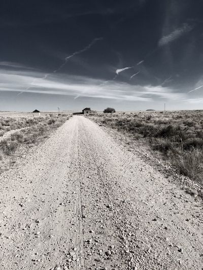 """""""Mystery Ranch"""" No. 4 in series. The Long Road In. Abandoned Places Abandoned New Mexico Photography New Mexico Perspective Dirt Road Roads Sky The Way Forward Landscape Nature Cloud - Sky Road Outdoors Scenics"""