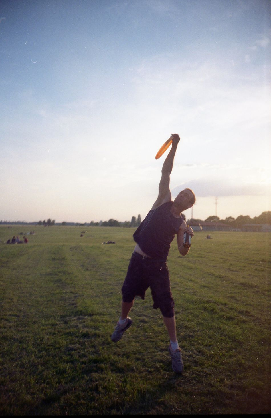 Frisbee with the beer just before the sunset. Beer Berlin Field Frisbee Grass Lomo Lomography Motion One Person Outdoors Sport Sunset Tempelhofer Feld