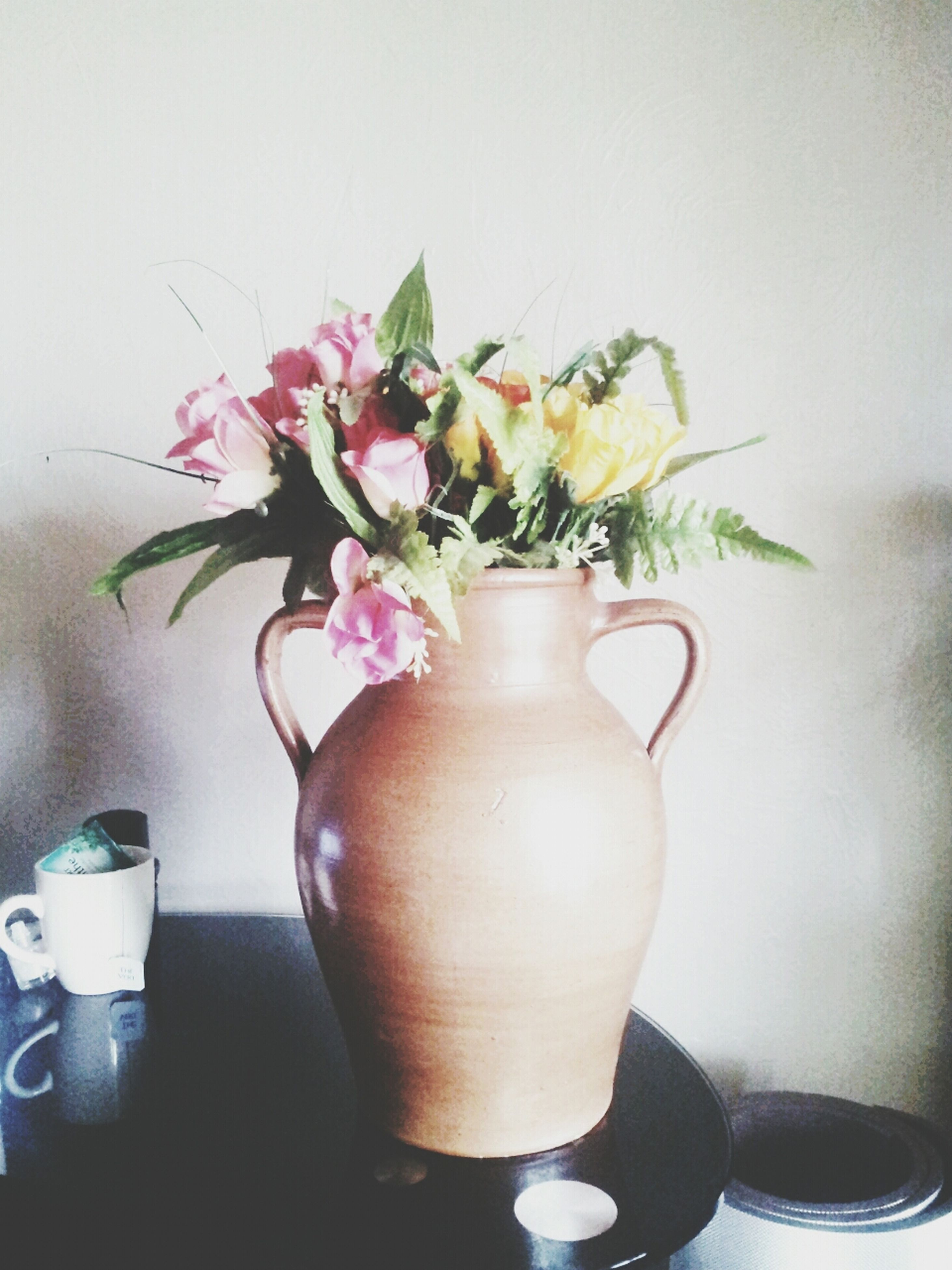 flower, indoors, vase, freshness, table, fragility, potted plant, petal, decoration, flower arrangement, flower head, home interior, plant, close-up, bunch of flowers, still life, wall - building feature, flower pot, bouquet, growth