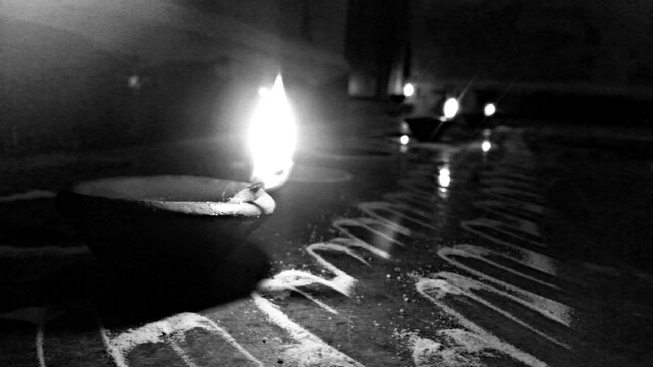 Monochrome Photography Flame Illuminated Burning Flooring Candle Fire - Natural Phenomenon Selective Focus Lens Flare In Front Of Surface Level Paving Stone Diwali Lights Flame Illuminated Burning Candle Flooring Fire - Natural Phenomenon Heat - Temperature Selective Focus Paving Stone Lens Flare Surface Level Lit
