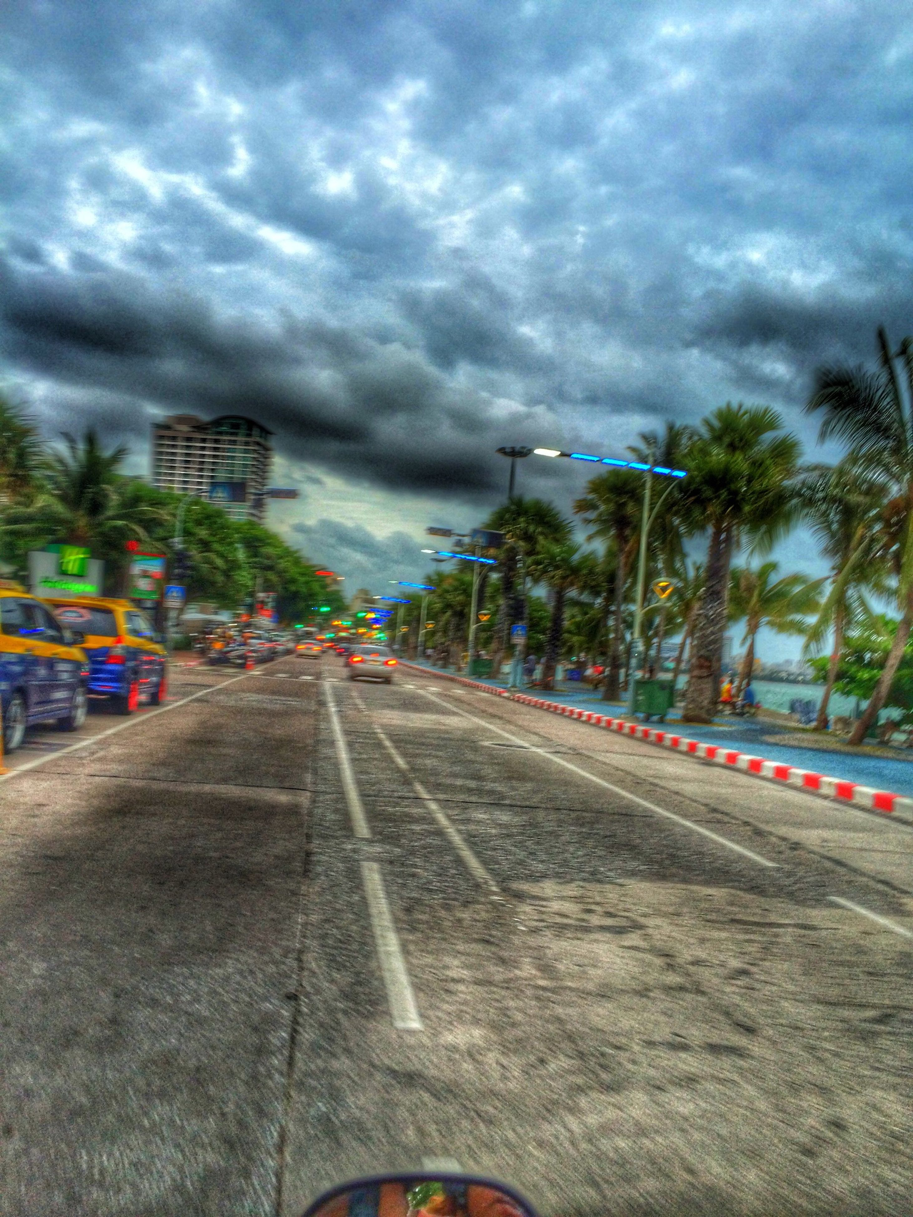 cloud - sky, sky, cloudy, transportation, the way forward, road, cloud, weather, land vehicle, street, storm cloud, road marking, overcast, car, diminishing perspective, tree, mode of transport, dramatic sky, vanishing point, dusk