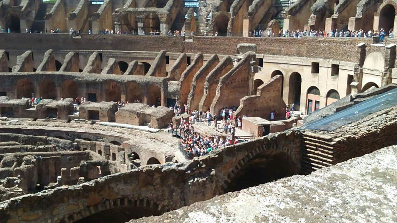 history, architecture, arch, real people, large group of people, built structure, old ruin, travel destinations, ancient, tourism, archaeology, travel, day, ancient civilization, leisure activity, outdoors, lifestyles, architectural column, vacations, building exterior, men, people