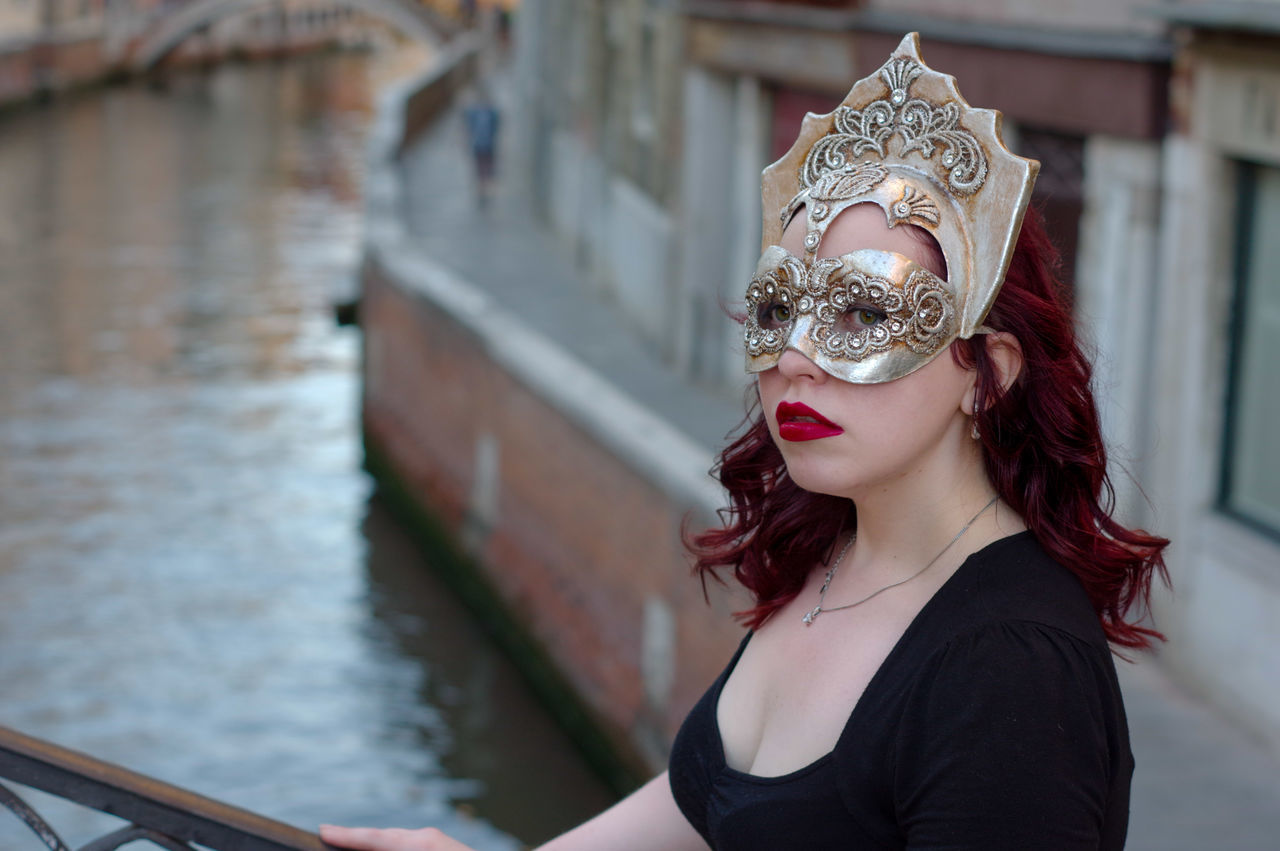 focus on foreground, one person, front view, real people, leisure activity, day, venetian mask, outdoors, portrait, young women, young adult, close-up