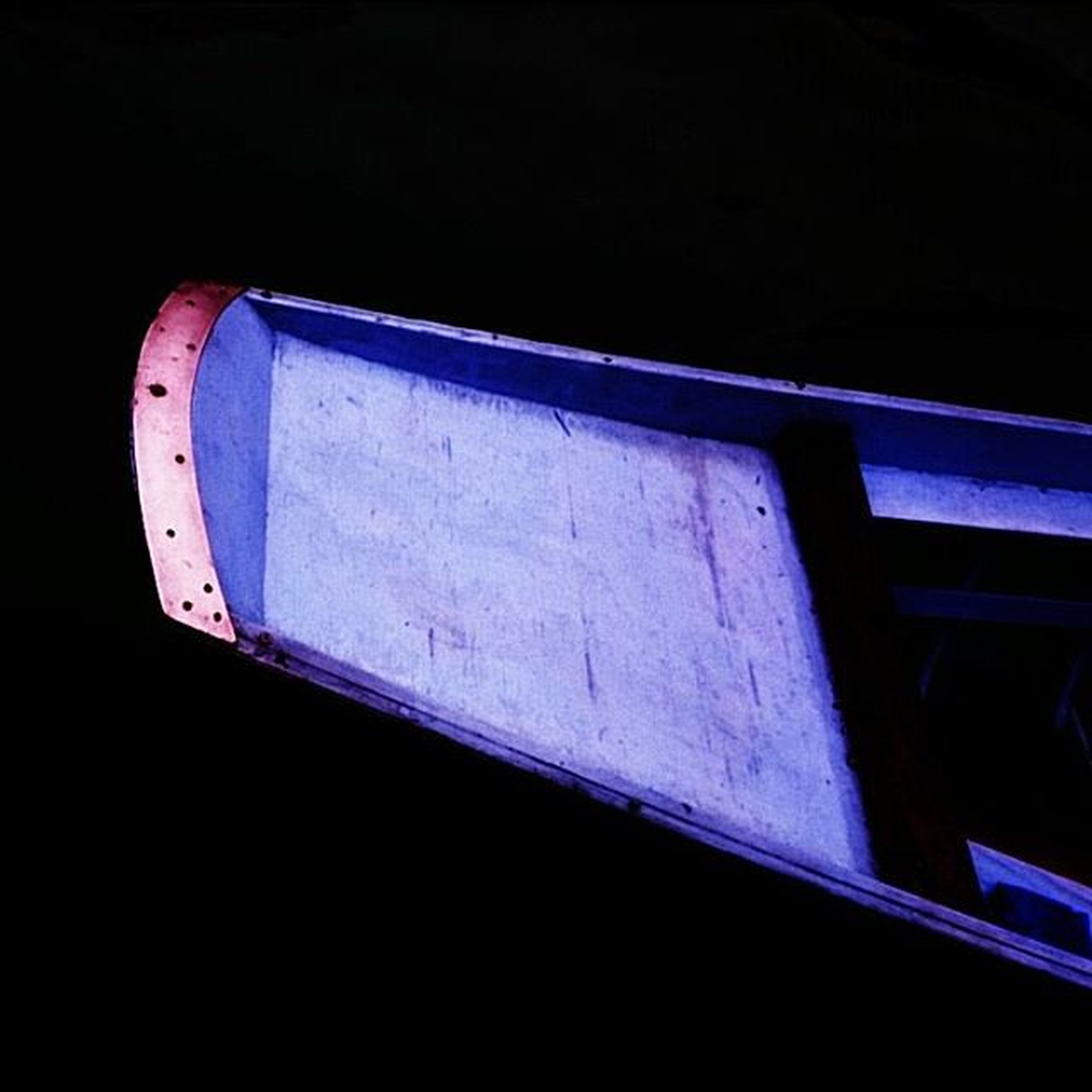 night, copy space, blue, low angle view, clear sky, transportation, built structure, dark, architecture, no people, outdoors, wood - material, metal, part of, illuminated, railing, close-up, mode of transport, boat