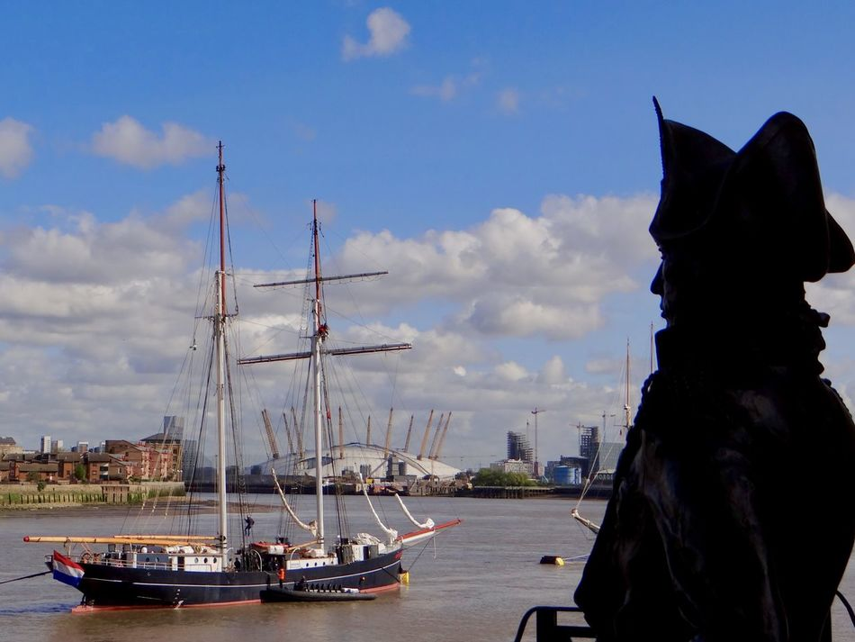 Lord Nelson looks out at a French ship Architecture City Cloud - Sky Day Lord Nelson Mast Mode Of Transport Moored Nautical Vessel No People O2 Arena Outdoors Sailing Ship Sky Statue Tall Ship Thames River Transportation Travel Destinations Water