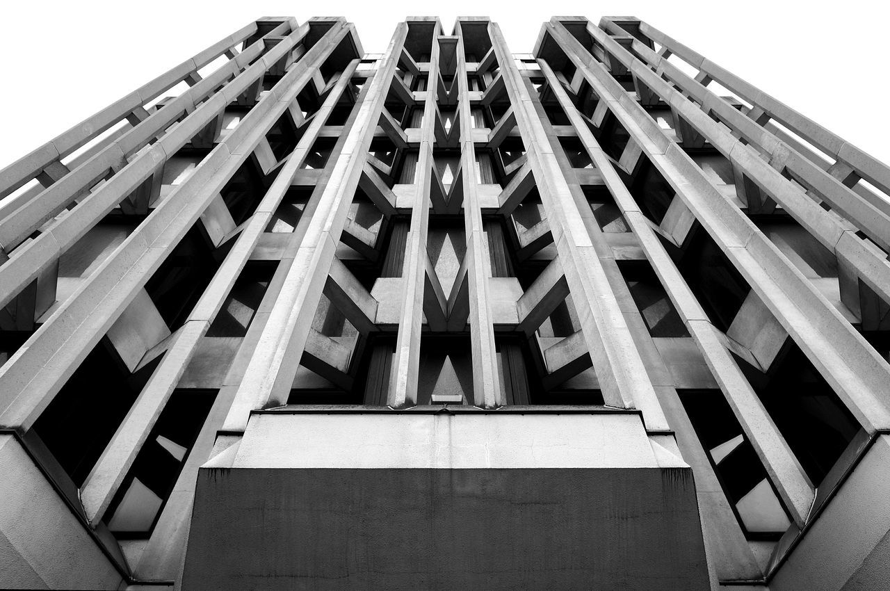 Architectural Feature Architecture Blackandwhite Building Building Exterior Built Structure Concrete Development Diminishing Perspective Façade Geometric Shape Lines Low Angle View Modern Office Building Outdoors Pattern Repetition Tall Tall - High Tower Symmetry Monochrome Photography