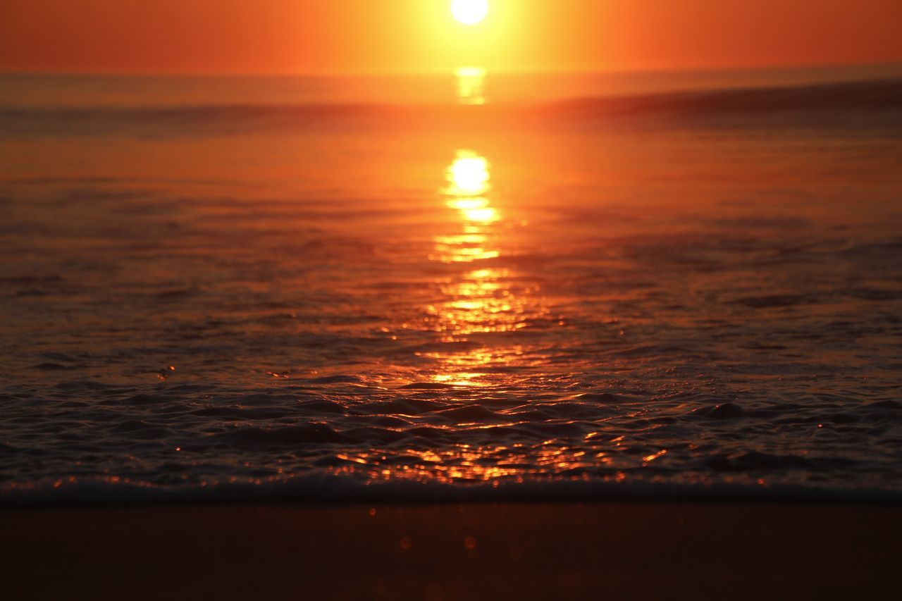 sunset, sea, sun, beauty in nature, scenics, nature, orange color, tranquility, tranquil scene, water, horizon over water, reflection, sunlight, idyllic, sky, silhouette, no people, outdoors, wave, beach